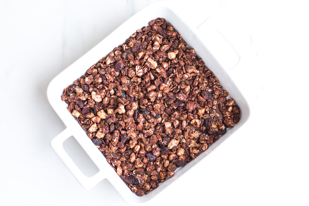 Crunchy Peanut Butter Chocolate Granola Recipe: Perfect for a comforting breakfast, a yummy snack or sprinkled on top of wintry crumbles! https://www.spotebi.com/recipes/crunchy-peanut-butter-chocolate-granola/