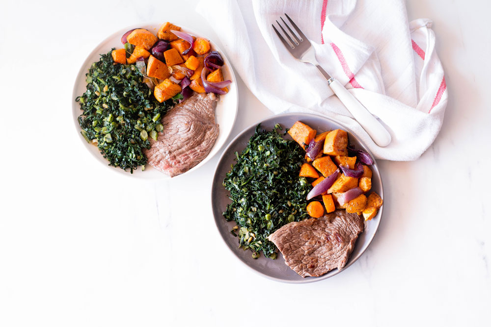 This quick and easy recipe is an example of a well-rounded lunch or dinner: Grilled steaks marinated in olive oil and spices (protein/healthy fat) topped with roasted veggies (carbohydrate/veggies) and sautéed garlic kale (greens/healthy fat). https://www.spotebi.com/recipes/grilled-steak-roasted-veggies-sauteed-kale/
