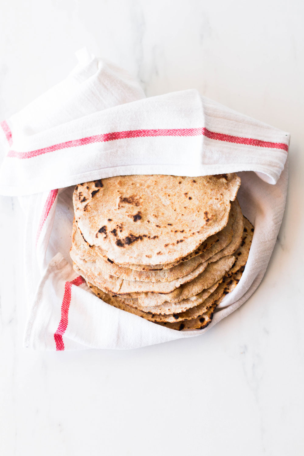 These easy 6-ingredient spelt tortillas are perfect for taco nights, you can make nachos with them and, since spelt is a non-GMO wheat variety, they're also great to test if you're intolerant to gluten or if you're just sensitive to genetically modified wheat (the kind of wheat that's commonly used in processed foods). https://www.spotebi.com/recipes/easy-6-ingredient-spelt-tortillas/