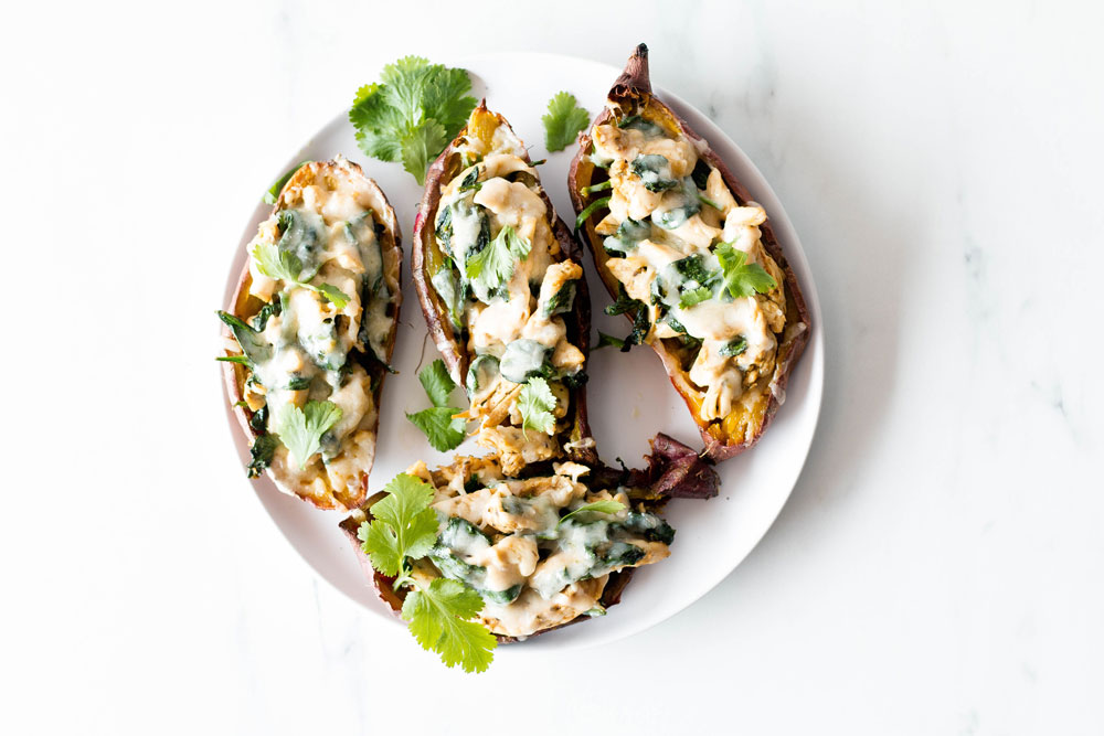 This easy and cheesy turkey stuffed sweet potato skins recipe uses up leftover meat and veggies from all the winter festivities. It's a low-carb and low-calorie dish, meaning you can cycle your calories and continue making progress despite the high-calorie feasts that mark the holiday season. https://www.spotebi.com/recipes/cheesy-turkey-stuffed-sweet-potato-skins/