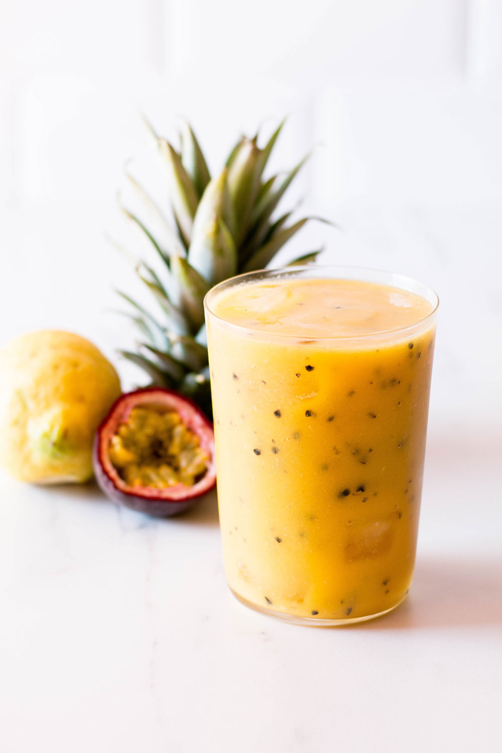 This passion fruit, mango, and pineapple tropical smoothie is packed with vitamin C and helps keep your skin tight, glowy and protected from the sun! https://www.spotebi.com/recipes/passion-fruit-mango-pineapple-tropical-smoothie/
