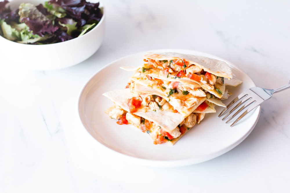 Quesadillas are a crowd favorite, and this easy chicken quesadilla recipe is a quick, filling, delicious lunch, dinner, or breakfast recipe that is ready in under 30 minutes. https://www.spotebi.com/recipes/easy-chicken-quesadilla-recipe/