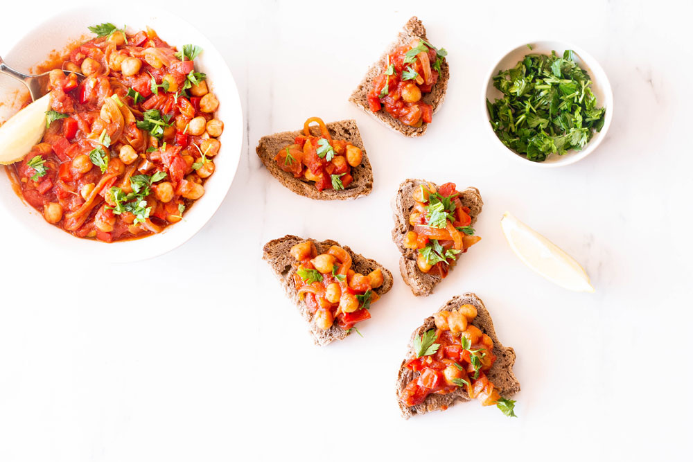 This Spicy Chickpea, Tomato & Bell Pepper Toast is the cold-weather alternative to the quintessential hummus toast. It's warm, comforting, easy to eat on the couch, and perfect to heat yourself up! https://www.spotebi.com/recipes/spicy-chickpea-tomato-bell-pepper-toast/