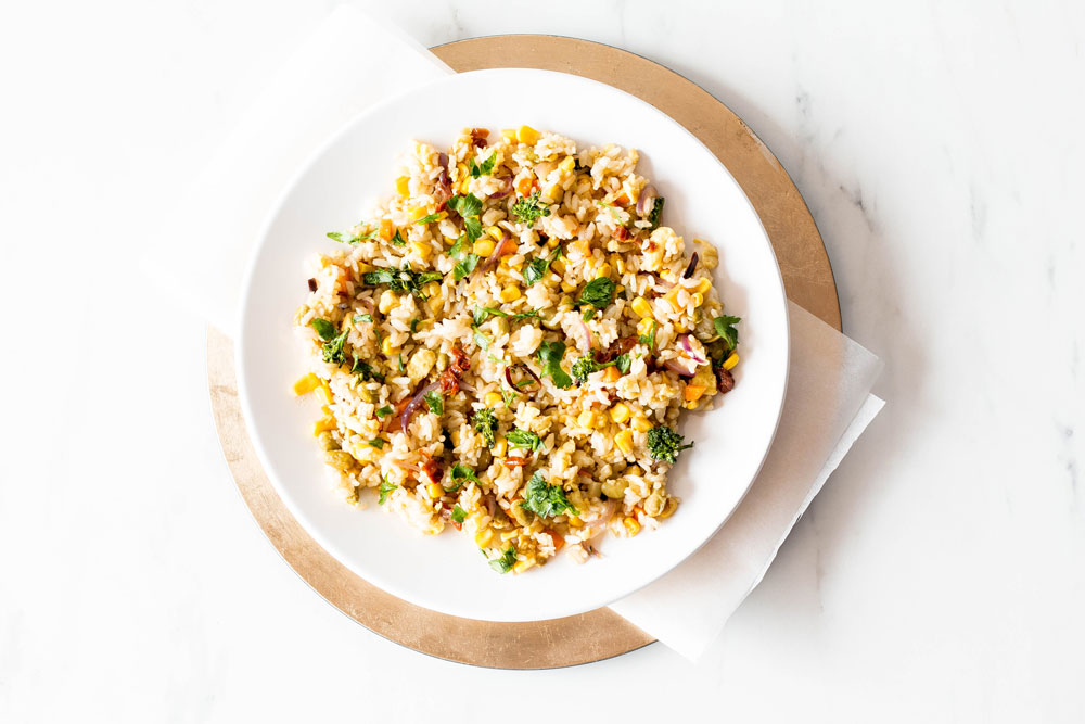 This Fried Leftover Rice with Edamame & Veggies is a clean-out-the-fridge vegan and gluten-free stir-fry that turns leftovers into a quick and easy weeknight dinner! https://www.spotebi.com/recipes/fried-leftover-rice-edamame-veggies/