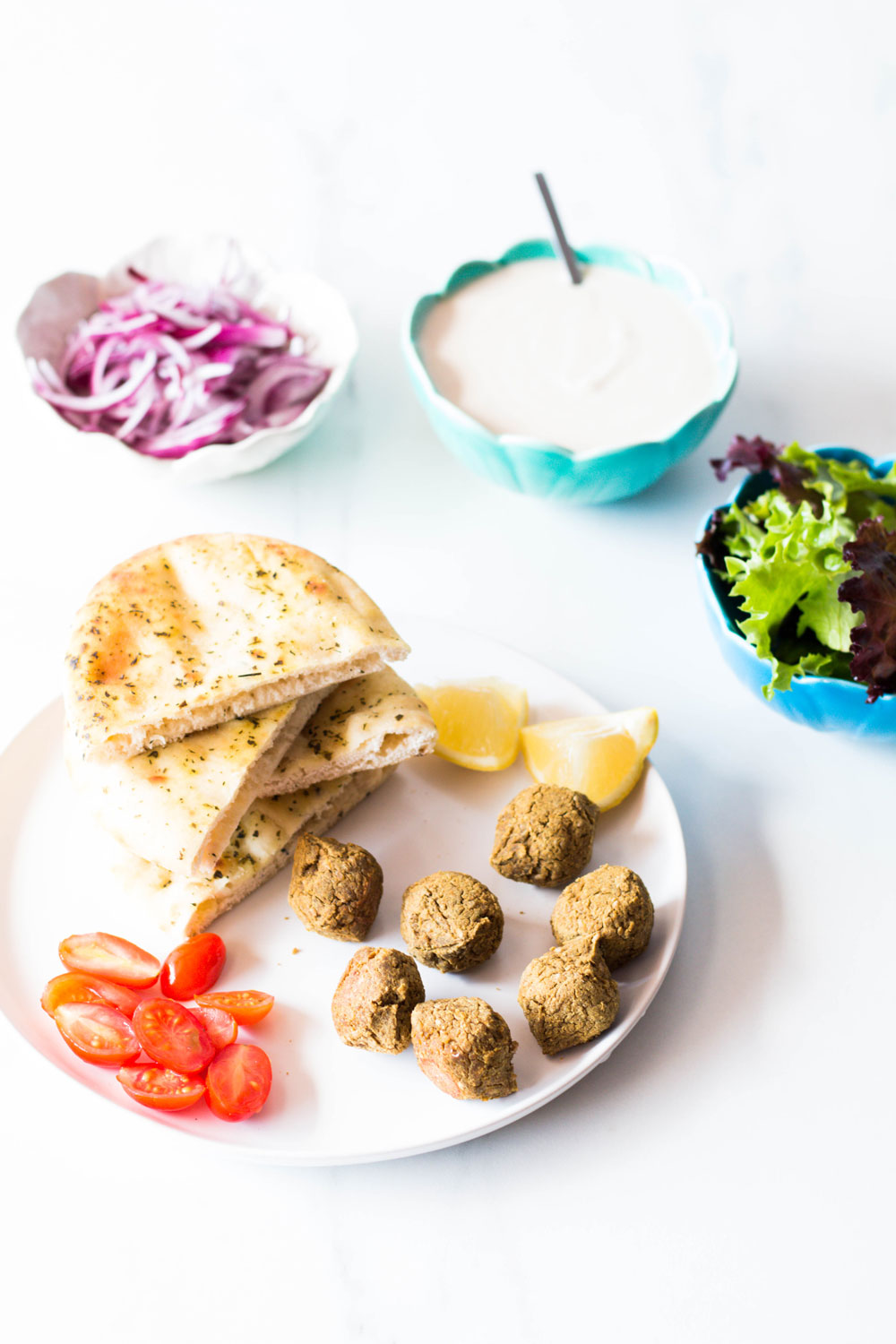 These Baked Sweet Potato Falafels with Creamy Tahini Sauce are one easy-to-make midweek dinner. They can be baked or fried, taste incredible in pita sandwichs or salads, and are gluten-free and vegetarian! https://www.spotebi.com/recipes/baked-sweet-potato-falafels-creamy-tahini-sauce/