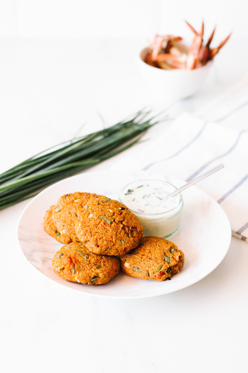 These Light & Simple Baked Crab Cakes are low in fat, and each cake only contains around 50 calories. They're made with simple, wholesome ingredients, and you can serve them with a fresh green salad, oven-roasted veggies, or our delicious summer gazpacho. https://www.spotebi.com/recipes/light-simple-baked-crab-cakes/